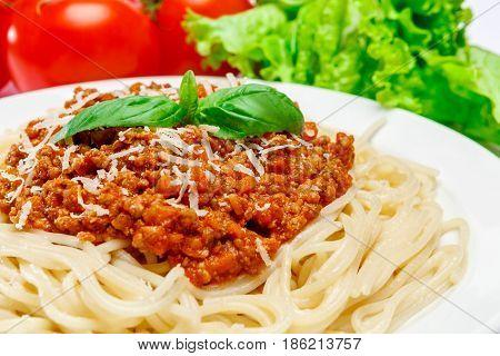 Traditional italian spaghetti bolognese on a white plate