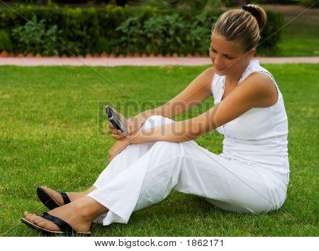 Woman Sit On A Lawn