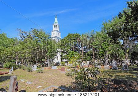 BEAUFORT SOUTH CAROLINA - APRIL 16 2017: Main building spire and part of the graveyard at the parish church of St. Helena. The current building dates from 1842 and hosts an Anglican congregation.