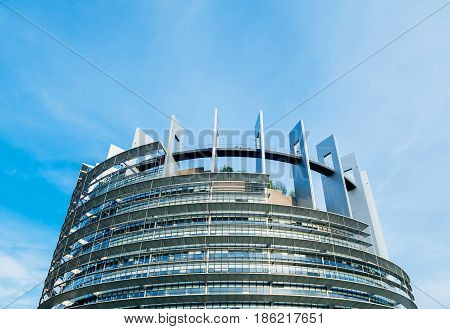 STRASBOURG FRANCE - MAR 31 2017: Wide large view over Official European Union flags - European Parliament building in Strasbourg France