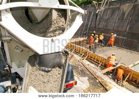Truck Operator Pouring Cement With A Pump