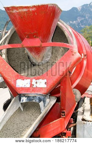 Bissone, Switzerland - 22 May 2009: Truck operator pouring cement into crane bucket with a cement truck mixer