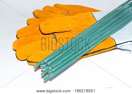 Electrodes For Welding Gloves For Welders On A White Background. Accessories For Welding Works.