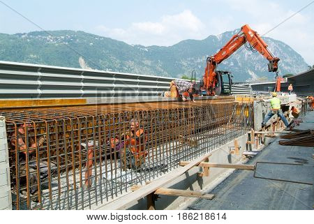 Worker Tying Rebar For Construction Of A Highway