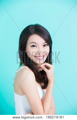 beauty skincare woman smile to you on green background