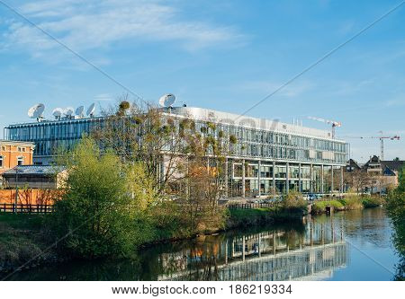 STRASBOURG FRANCE - Apr 12 2017: Arte (Association Relative a la Television Europeenne) television headquarter in Strasbourg elevated view with ILL river on a spring morning