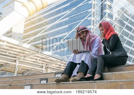 Arab Businessman and Businesswoman using computer finance concept