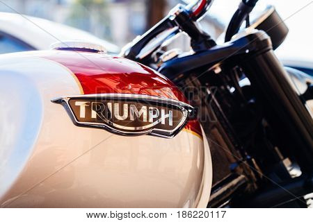 STRASBOURG FRANCE - APR 3 2017: Triumph Motorcycles logotype on a parked bike on city street. Triumph is the largest British motorcycle manufacturer; it was established in 1984 by John Bloor after the original company Triumph Engineering went into receive