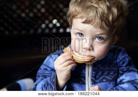 Boy Eating Curd Ring Cake