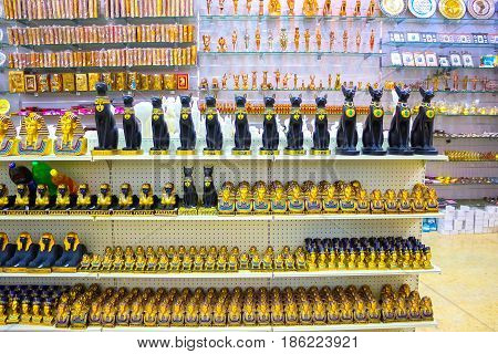 Sharm El Sheikh, Egypt - April 13, 2017: Alabaster cats and statuettes in abstract Egyptian souvenir shop. Selective focus
