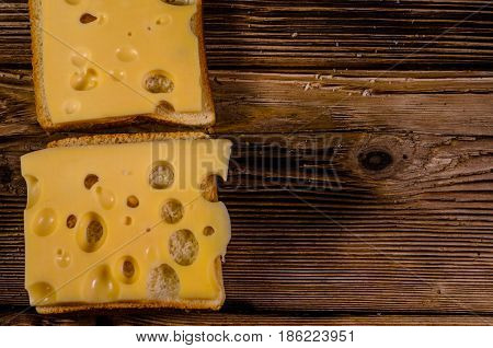 Sandwich With Cheese On Wooden Table