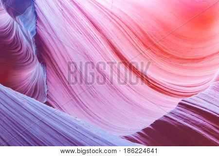 Abstract multi-color swirling pattern and color transitions in the limestone formations underground Lower Antelope Canyon Page Arizona USA