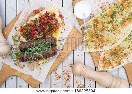 Kebab And Gozleme .traditional Oriental Meat Kebab Of Minced Beef Or Lamb With Vegetables And Herbs