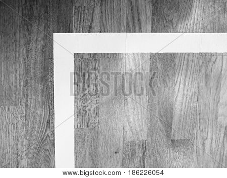 White Corner. Worn Out Wooden Floor Of Sports Gym With Colorful Marking Lines