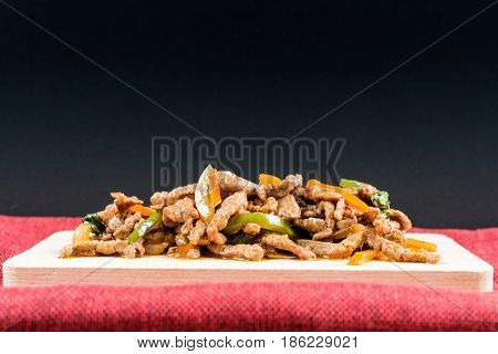 wok fried beef stir fry with sweet peppers and chinese vegetables