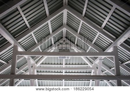 White Construction Beams Of A Large Gazebo On The Lake. Roof Made Of Wooden Beams Painted White.