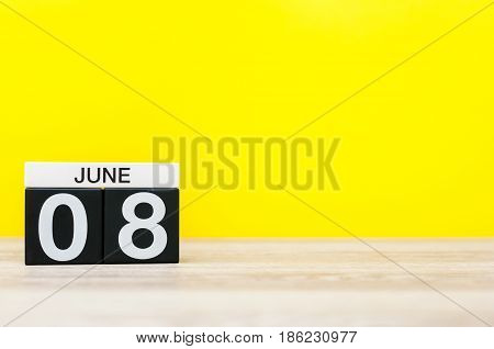 June 8th. Day 8 of month, calendar on yellow background. Summer day, empty space for text. International Cleanup Day.