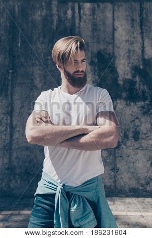 Young Hot Bearded Guy In Casual Clothes Outdoors. His Hairdo Is So Stylish And His Arms Are So Muscu