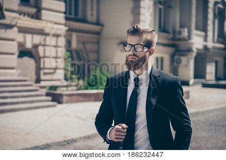 Success Concept. Stylish Harsh Bearded Guy In A Suit And Glasses. So Stylish And Stunning! Outdoors