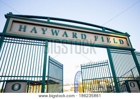 EUGENE, OR - MAY 7, 2017: Runners pass below the main gate into Historic Hayward Field during the 2017 Eugene Marathon race held on the University of Oregon campus.