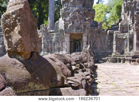 Buddha figure at the entrance of Preah Khan Temple.