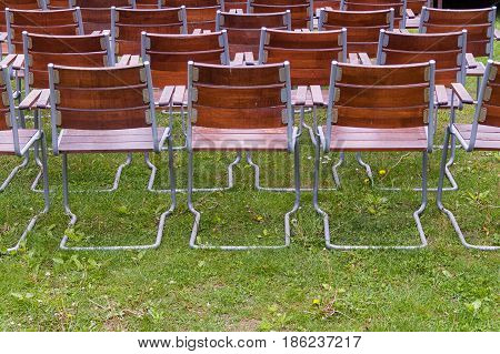 Empty, Wooden Metal Chairs Of An Open Air Garden Theater From Back,horizontal