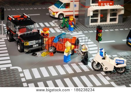 MOSCOW, DECEMBER 25, 2016: Lego City scene road accident - violation of traffic lights and regulations. Violation of traffic safety rule. Example for children. Ambulance police car bike