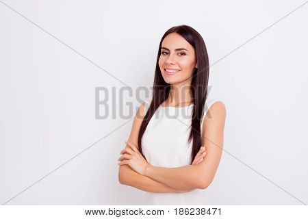 Close Up Portrait Of Confident Successful Brunette Girl In White Outfit Standing On Pure Background