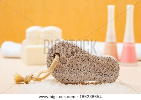 Feet nails care. Pedicure accessories set tools: soap varnish and stone pumice with foot print