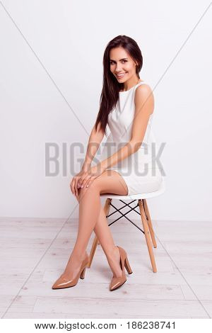 Full Size Portrait Of Successful Gorgeous Lady. She Is Wearing Formal White Stylish Dress And High H