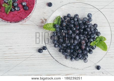 Delicious bilberry smoothie with fresh berries. Fresh yogurt with bilberry. Healthy breakfast.