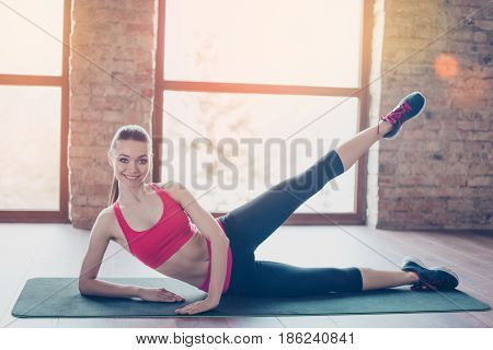 Attractive Young Lady Is Doing Stretching Before Start Her Training, To Be Bendy And Flexible. She I