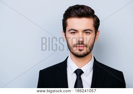 Close Up Portrait Of Handsome Serious Confident Young Manager In Formal Clothes Isolated On Gray Bac