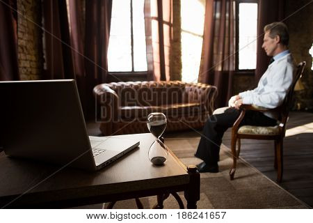 Psychology concept. Treatment of mental ailments, diseases, etc. Psychiatrist man staying in his office and waiting for patients.