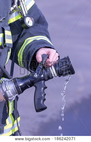 Water extingisher in hands close up view.