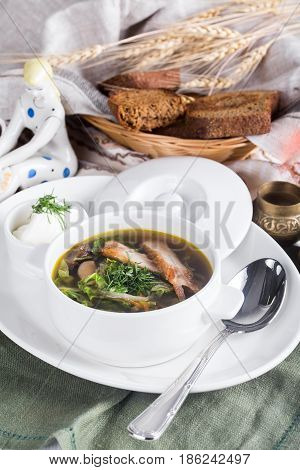 beef noodles soup on a serving table with bread.