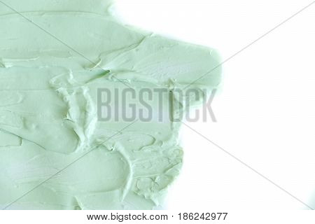 clay mask for face and body. natural clay mask for face and body. Green cosmetic clay texture close up. a solution of cosmetic clay abstract background