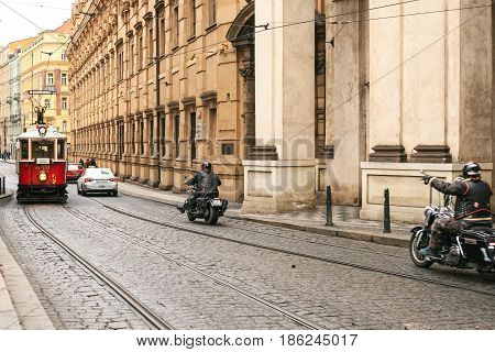 Czech Republic, Prague, December 24, 2016: Authentic and unusual city of Prague. On the roads go vintage trams and bikers on modern motorcycles.