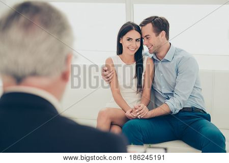 Love, Family, Phychology And Happiness Concept - Young Couple Hugging At Psychologist Office, They A