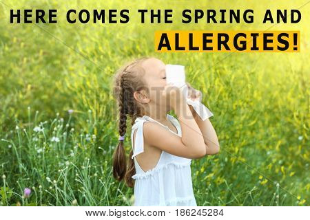Pollen allergy. Little girl with tissue outdoor