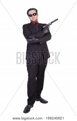 Handsome man holding gun isolated on white background.