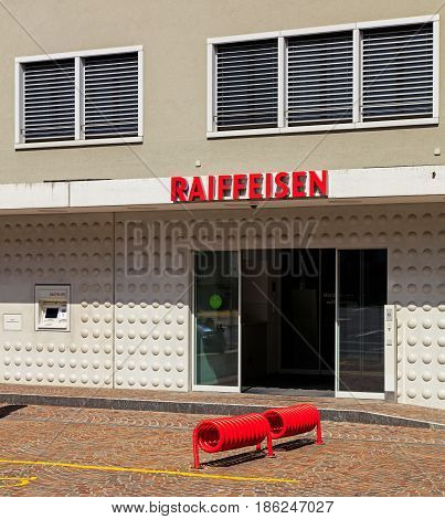 Einsiedeln, Switzerland - 7 September, 2015: entrance to an office of the Raiffeisen bank. Raiffeisen is a Swiss cooperative bank, it is the third largest bank in Switzerland, after UBS and Credit Suisse.