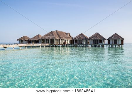 Water villas and crystal blue ocean in the Maldives
