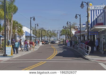Tarpon Springs, Florida, USA - January 25, 2017: Tourists explore Tarpon Springs on a sunny day. Tarpon Springs is located on the Gulf of Mexico and called