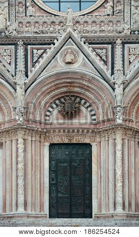Siena Cathedral door closeup as the famous landmark in medieval town in Italy.