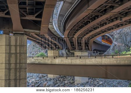 Bridges over Colorado RIver and tunnel of I-70 freeway in Glenwood Canyon, Colorado
