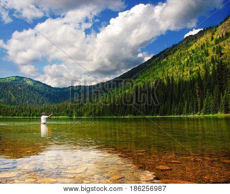 Man fishing at Moose Lake near Kalispell and Whitefish, Montana