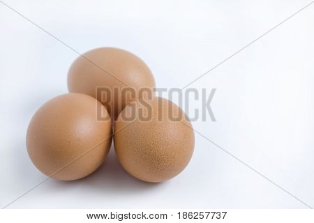 Three eggs isolated from the white background.