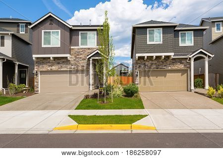 Tract homes front in new subdivision in North America suburban residential neighborhood