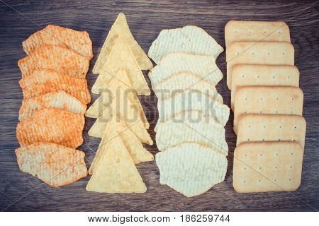 Vintage Photo, Crunchy Cookies And Salted Potato Crisps, Concept Of Unhealthy Food